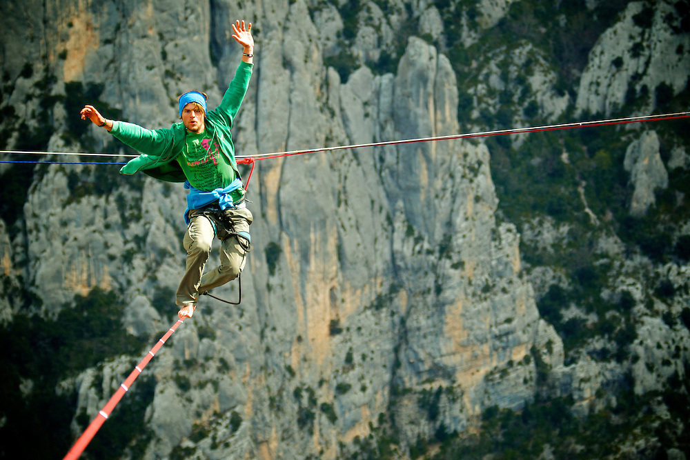 Elephant Slacklines ambassador Alexander Schultz on the return of his first FM ascent of the shortest leg of the first SPACE line, 300m high, and 65, 45,30m legs, rigged in the Sordidon sector of Verdon Gorges, France. A very, very saggy line indeed!! Even for the pros! ..2012 © Pedro Pimentel