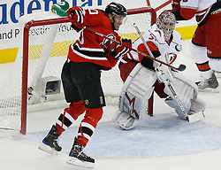 Apr 15, 2009; Newark, NJ, USA; New Jersey Devils left wing Jay Pandolfo (20) tries to hit the puck after a save by Carolina Hurricanes goalie Cam Ward (30) during the first period of game one of the eastern conference quarterfinals of the 2009 Stanley Cup playoffs at the Prudential Center.