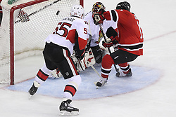 Apr 7; Newark, NJ, USA; New Jersey Devils right wing Stephen Gionta (11) scores his first NHL goal past Ottawa Senators goalie Craig Anderson (41) during the third period at the Prudential Center. The Devils defeated the Senators 4-2.
