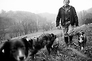 Nancy Bircher walks the dogs on the farm she runs with her husband, Dave, in Guysville, OH.