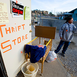 111011       Brian Leddy.Gloria Johnson holds up a box of muffins for a customer at the Church of the Nazarene Thrift Store Thursday afternoon. The shop recently opened it's doors.