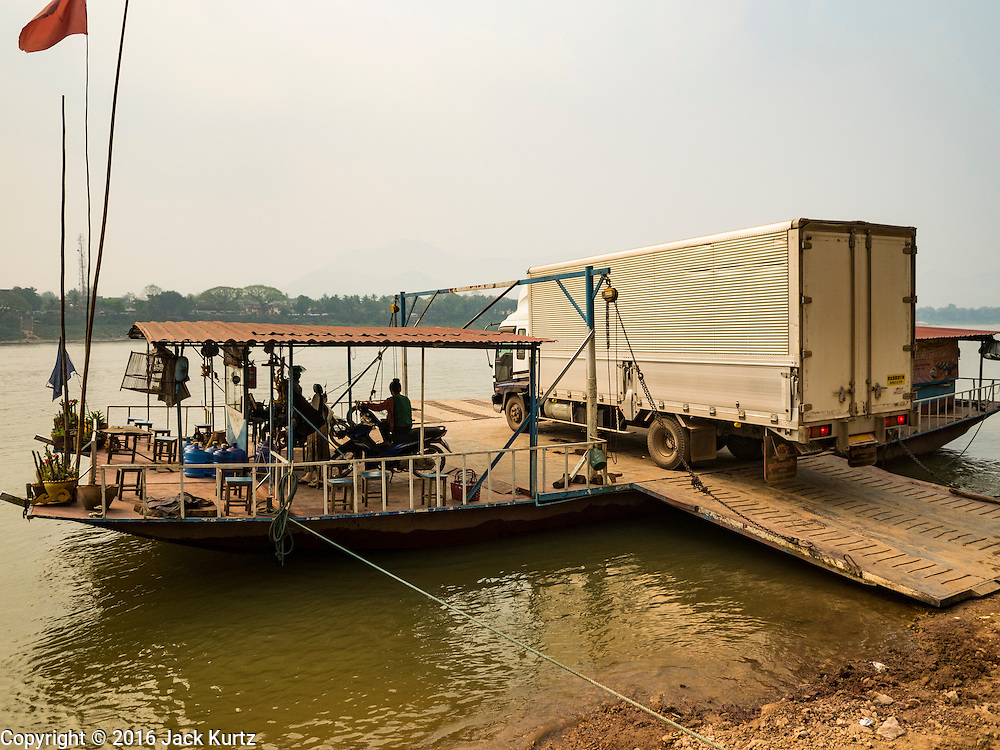 11 MARCH 2016 - LUANG PRABANG, LAOS: A large truck on a ferry on the Mekong River near Luang Prabang. Laos is one of the poorest countries in Southeast Asia. Tourism and hydroelectric dams along the rivers that run through the country are driving the legal economy.       PHOTO BY JACK KURTZ