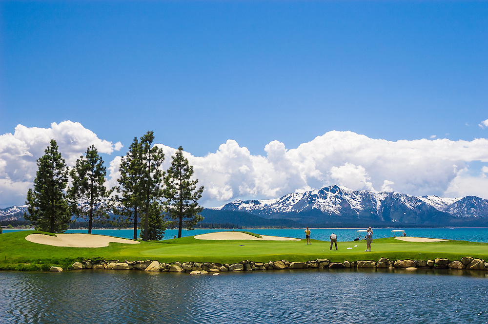 Golfers at 18th hole of Edgewood Lake Tahoe Golf Course; Stateline, Nevada.