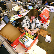 """DENVER - FEBRUARY 26:  Rocky Mountain News courts reporter Sue Lindsay packs up a box with some of her personal belongings Thursday at her desk in the newsroom. The Rocky Mountain News, one of two of Denver's daily newspapers, announced Thursday February 26, 2009 that tomorrow's edition would be the final one of the newspaper's almost 150 years of publishing. The newspaper had been put up for sale by its owner, E.W. Scripps, but the search for a buyer proved unsuccessful. """"Denver can't support two newspapers any longer,"""" Scripps CEO Rich Boehne told staffers, some of whom cried at the news. """"It's certainly not good news for you, and it's certainly not good news for Denver."""" The Rocky was founded in 1859 by William Byers, one of the most influential figures in Colorado history. Scripps bought the paper in 1926 and immediately began a newspaper war with The Post. That fight ebbed and flowed over the course of the rest of the 20th century, culminating in penny-a-day subscriptions in the late '90s. The closure will cost 228 newsroom employees their jobs..(Photo by Marc Piscotty/ © 2009)"""