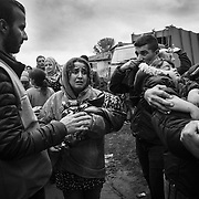 A woman is in distress after being separated from the rest of her family in the shuffle to get to a bus near Tovarnik's train station, Croatia.<br />