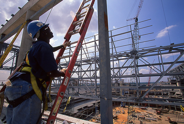 Man Climbing A Ladder At The Construction Site Of Reliant