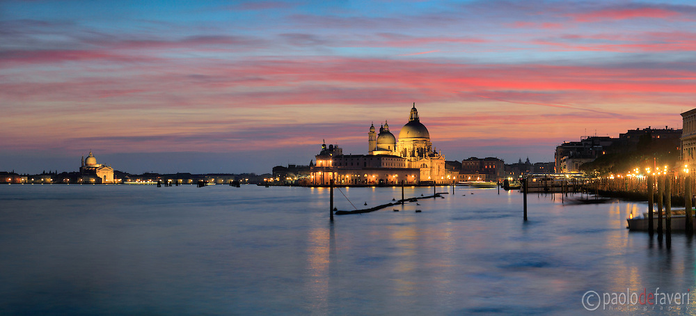 Beautiful stripes of red clouds over the church of Nostra Signora della Salute and Punta della dogana. Taken about 20 minutes after sunset from Riva degli Schiavoni, on an evening of mid January, this is stitched from 10 vertical frames.