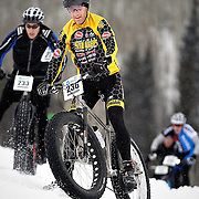 SHOT 2/9/13 5:51:03 PM - Ian Anderson (#236) of Carbondale, Co. makes his way down a slippery slope as he descends during the On-Snow Mountain Bike Crit at the second annual Winter Mountain Games presented by Eddie Bauer at Vail Ski Resort in Vail, Co. The Winter Mountain Games feature competitions in X-Country On-Snow Mountain Bike Races, mixed climbing, Telemark Big Air,Best Trick Bike and On-Snow Mountain Bike Crit with more than $60,000 in prize money on the line. (Photo by Marc Piscotty / © 2013)