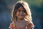Little girl in Pune market in Oecusse. Photo UNMIT/Martine Perret .11 August 2011