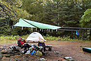 Relaxing with a cup of coffee, while canoe camping in the Boundary Waters of northern Minnesota. ..