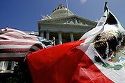 US and Mexican flags fly in front of the State Capitol in Sacramento, CA during a nationwide day of marches to demonstrate immigrant's contribution to the economy on Monday, May 1, 2006.<br />