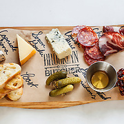 A charcuterie board with local cheeses and meats at Brooklyn and the Butcher in downtown New Albany.