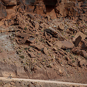 SHOT 10/17/16 11:08:31 AM - A mountain biker climbs the Shafer Trail section of the White Rim Trail. The White Rim is a mountain biking trip in Canyonlands National Park just outside of Moab, Utah. The White Rim Road is a 71.2-mile-long unpaved four-wheel drive road that traverses the top of the White Rim Sandstone formation below the Island in the Sky mesa of Canyonlands National Park in southern Utah in the United States. The road was constructed in the 1950s by the Atomic Energy Commission to provide access for individual prospectors intent on mining uranium deposits for use in nuclear weapons production during the Cold War. Four-wheel drive vehicles and mountain bikes are the most common modes of transport though horseback riding and hiking are also permitted.<br /> (Photo by Marc Piscotty / &copy; 2016)