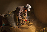 A member of a co-operative for blind and disabled people living in the town of Dong Ha in Vietnam's Quang Tri province assembles incense sticks. The co-operative supports itself in part through sale of the incense.
