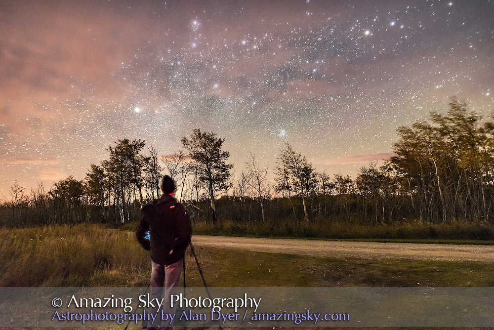A photographer with the September 23, 2016 Night Photography Workshop I conducted in Waterton Lakes National Park, Alberta, here at the Maskinonge picnic area to escape some of the clouds that night. We are looking NE to the Pleiades and Auriga.