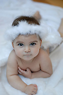 Six month year old baby girl dressed as a little angel
