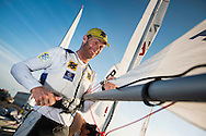 The Laser World Championships 2013 -  Standard. Mussanah Oman<br /> The final day of racing, Robert Scheidt (BRA) shown here celebrating after winning the championships<br /> <br />  Oman.Credit: Lloyd Images.