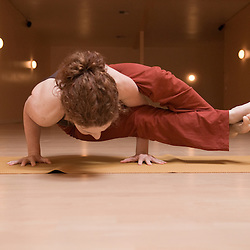 "Lisa Helfer, writer, yogi, and founder of Yoga For Weddings gets into ""Ashtavakrasana"" pose during her yoga workout."