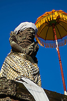 Balinese Togog with Umbrella  - a togog is a decorative sculpted head, often festooned with flowers.  The faces and expressions are usually taken from from Balinese folk tales and legends.