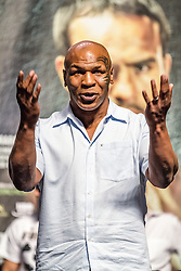 """LAS VEGAS, NV - DEC 7: Mike Tyson on stage at the Pacquiao vs Marquez 4 Weigh In at the MGM Grand Garden Arena in Las Vegas, NV to promote his charity function taking place at the MGM Grand on Friday night. Much of the fans gave him love and cheered for him as he screamed back saying, """"you better come out tonight."""" Byline and/or web usage link must  read PHOTO: © Eduardo E. Silva/SILVEX.PHOTOSHELTER.COM."""