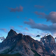 The full moon rises over the Valley of the Ten Peaks, an especially mountainous section of the Canadian Rockies in Banff National Park, Alberta, Canada.