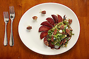 Pears poached in Burgundy wine, star anise and allspice. Served with bleu cheese, candied pecans on mixed greens.