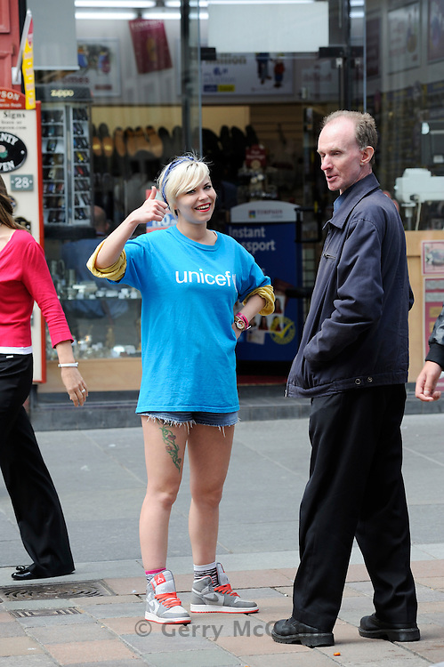 Glasgow, Scotland. Street fundraisers speak to people in Buchanan Street in a bid to raise funds for Unicef. They are also known as Charity Muggers or Chuggers. © Gerry McCann.