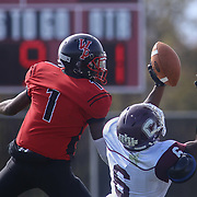 William Penn defensive back Zachariah Burton (1) deflect the ball as Concord wide receiver GrahmRoberts (6) attempts to catch it during a regular season football game between William Penn and Concord Saturday, Oct. 24, 2015 at  William Penn High School in New Castle.