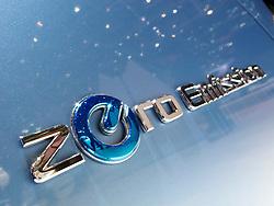 Close up of Zero Emission logo on Nissan electric car at the Geneva Motor Show 2011