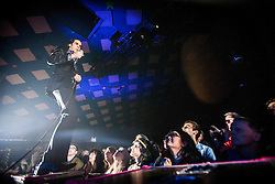 A wide angle shot of the frontman Nick Cave at the front of the crowd, Nick Cave and the Bad Seeds, on stage tonight at The Barrowlands, Glasgow, Scotland.<br /> &copy;Michael Schofield.