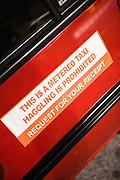 Sticker on taxi door.