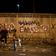 Supporters of extreme Neo Nazi party Golden Dawn await results from the election ballot count in Athens, Greece. Image © Angelos Giotopoulos/Falcon Photo Agency