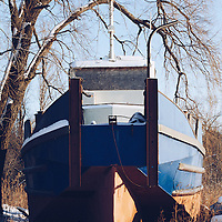 http://Duncan.co/boarded-up-boat-and-tree