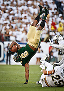 SHOT 9/19/15 5:37:37 PM - Colorado State's Jasen Oden Jr. #6 goes airborne after trying to hurdle a pair of Colorado defenders during the Rocky Mountain Showdown at Sports Authority Field at Mile High in Denver, Co. Colorado won the game 27-24 in overtime. (Photo by Marc Piscotty / © 2015)