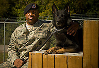 Staff Sgt. Ramon Alexander and his working dog, Waldo, of the 437th Security Forces pose for a portrait at Charleston Charleston Air Force Base, S.C., on Oct. 30, 2008.