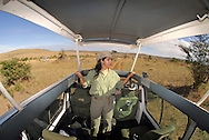 Tourists exploring the Masai Mara National Park on a four wheeler vehicle