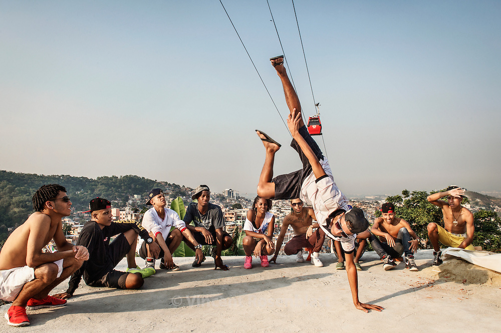 """Jackson """"Fantástico"""". Rehearsal of the show """"Na Batalha"""" on a rooftop of the Complexo do Alemão favelas. Elite dancers of the """"Passinho"""" (little step) the newest dance fever that came out the Baile Funk culture."""