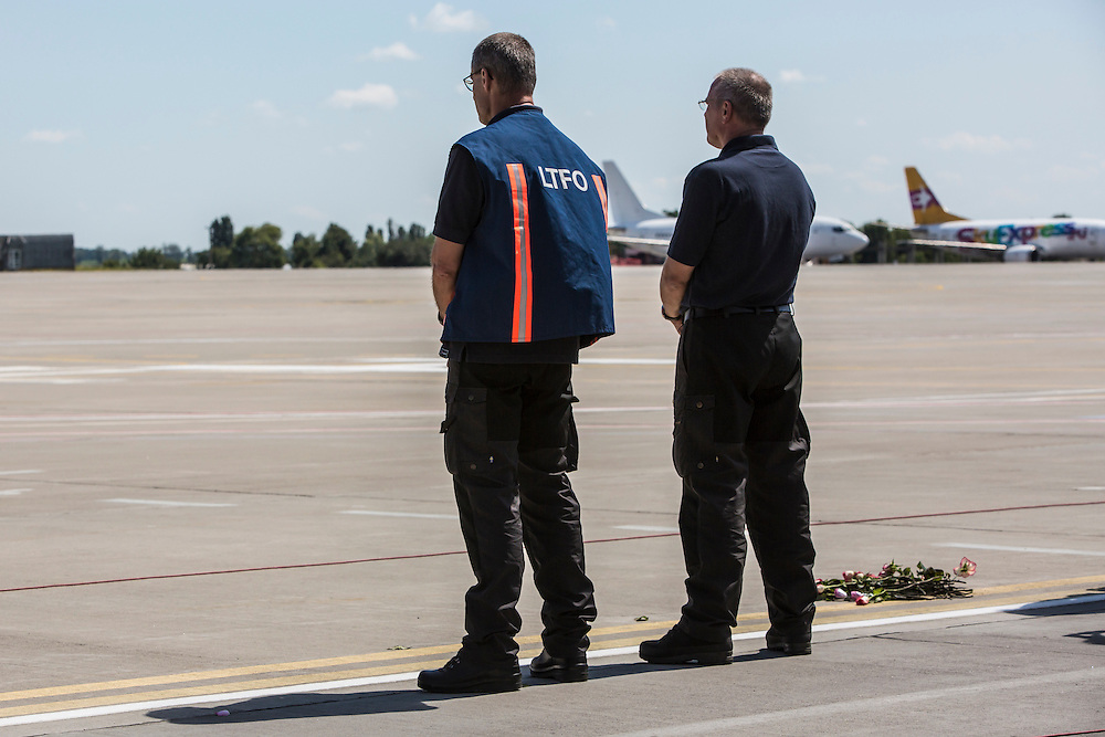 KHARKIV, UKRAINE - JULY 23: Peter van Vliet (L), leader of the Dutch forensics team investigating the crash of Malaysia Airlines flight MH17, watches a plane containing the bodies of crash victims takes off to the Netherlands during a departure ceremony on July 23, 2014 in Kharkiv, Ukraine. Malaysia Airlines flight MH17 was travelling from Amsterdam to Kuala Lumpur when it crashed killing all 298 on board including 80 children. The aircraft was allegedly shot down by a missile and investigations continue over the perpetrators of the attack. (Photo by Brendan Hoffman/Getty Images) *** Local Caption *** Peter van Vliet
