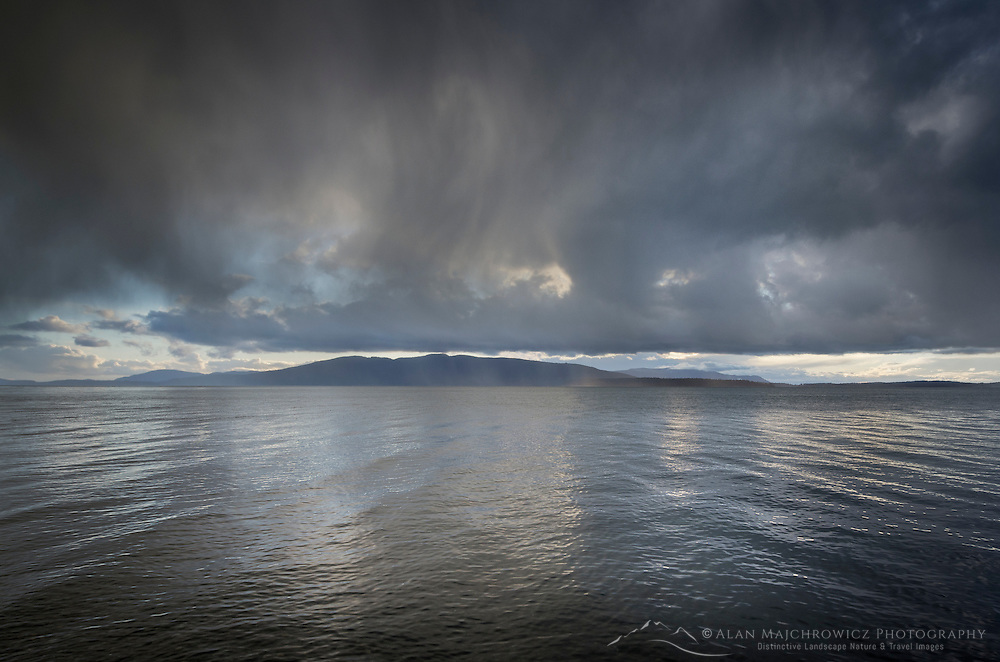 Stormy winter clouds over Bellingham Bay Washington. Lummi Island in the distance.