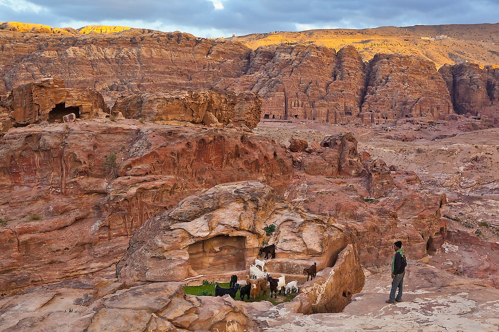 Bedouin shepherd Atala Mohammed herds his goats through the canyons of Petra, Jordan to a rare water spring.