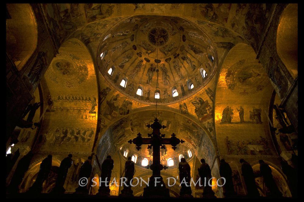 Gold Mosaics of the Basilica's Interior Domes with Cross and Saint Statues Silhouetted