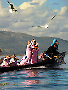 Buddhist nuns feed the seagulls on Inle Lake, Myanmar.