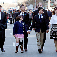 (Boston, MA - 4/15/15) Mayor Martin Walsh walks with Martin Richard's  sister, Jane, father, Bill, brother, Henry, and mother, Denise, after unveiling One Boston banners on Boylston Street at the site of one of the Boston Marathon blasts, which killed Martin two years ago, Wednesday, April 15, 2015. Staff photo by Angela Rowlings.