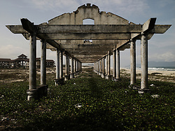 Perspective of an archway in decay from a real estate resort project stopped by contractors because of missing funds. Da nang province, Viet nam, Asia