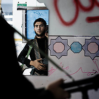 SYRIA, ALEPPO. Rebel fighter gets ready for going to the front line, on September 28, 2012. ALESSIO ROMENZI