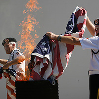 PT_297323_FITT_pasvet_2.(Holiday 11/11/2008).BRENDAN FITTERER   Times.Robert Farrell, right, and Fred Faulkner, both of the VFW Post 10167 Honor Guard, burn old, damaged flags for proper disposal outside the Post on Bartelt Road in Holiday following Tuesday's annual Veterans Day Ceremony..SUMMARY:. Veterans Day ceremony. VFW Post 10167 will hold its Veterans Day ceremony at 11 a.m. Tuesday at 4619 Bartelt Road, Holiday, (727) 938-5977. The public is welcome to bring old, damaged flags for proper disposal.
