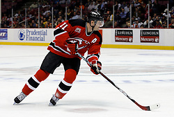 Mar 30, 2007; East Rutherford, NJ, USA; New Jersey Devils center John Madden (11) skates during the second period at Continental Airlines Arena in East Rutherford, NJ.