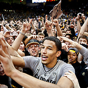 SHOT 2/14/13 10:01:17 PM - Colorado's Andre Roberson #21 celebrates with fans after upsetting Arizona during their regular season Pac-12 basketball game at the Coors Event Center on the Colorado campus in Boulder, Co. Colorado won the game 71-58. (Photo by Marc Piscotty / © 2013)