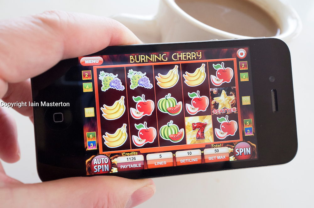 Playing slot machine game on an iPhone 4G smart phone