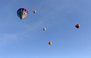 Hot air balloons dot the sky above Howard Tietan Park in Walla Walla, Wa.  More than 30 hot air balloons lift off a few minutes after sunrise for the 41st annual Balloon Stampede.  <br />